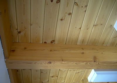 Lodge Pole Pine Select Decking on second story between ceiling and roof